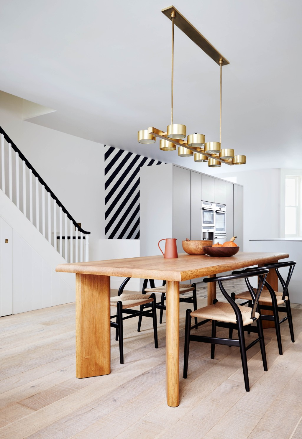 Restrained but strikingly eclectic notting hill for Modern kitchen table lighting