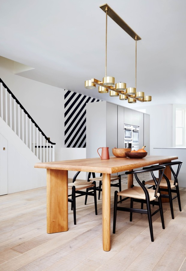 Feature, Notting Hill town house, contemporary, modern, graphic, geometric patterns, family home, bright, interior, dining area, kitchen, brass pendant light
